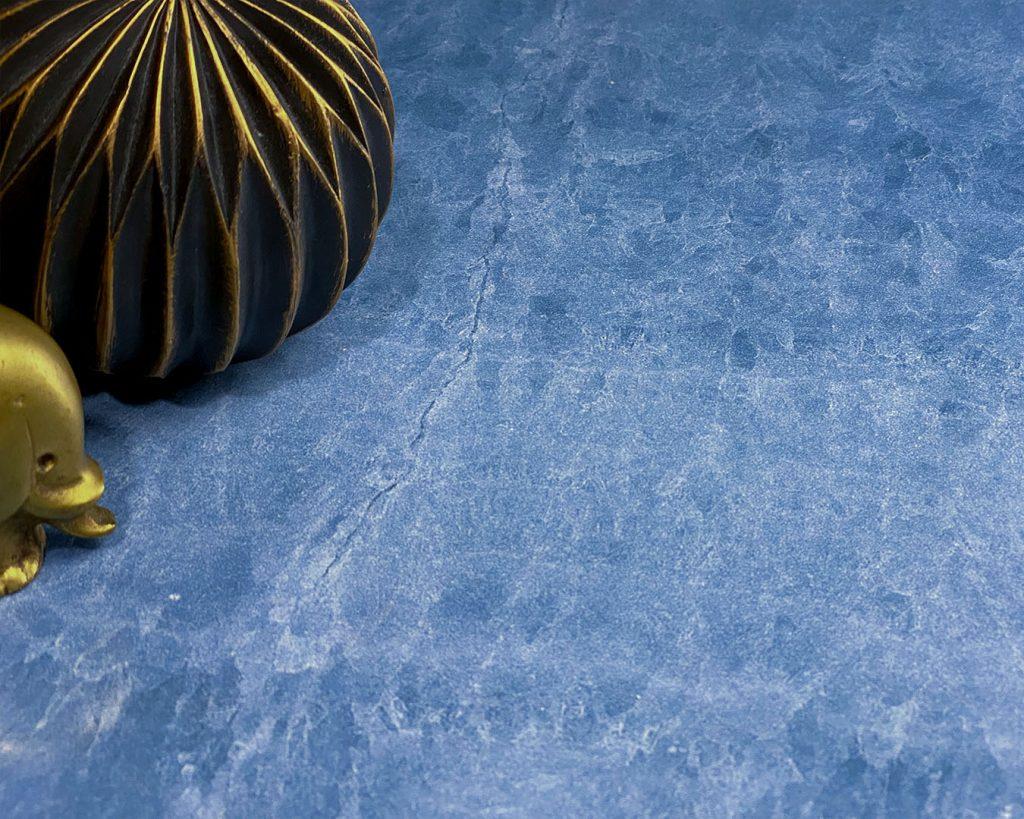 Copertina Marmi Pregiati Onice blu con oggettistica oro per accedere alla pagina della serie